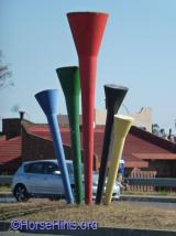 Vuvuzela Statue on street curb outside Mandela Museum